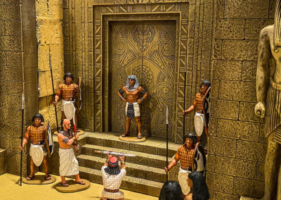 Pharaoh accepting a defeated enemies sword at the temples gate