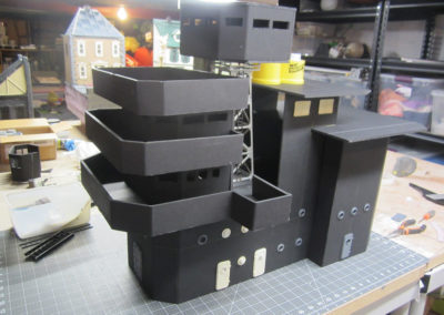 The decks were constructed from foam core board and each corner was carved with a V-shaped tool before carefully bending to get the right shape. White Elmers glue was used to attach everything together.