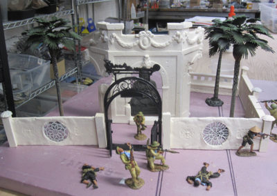The Buddhist temple before painting. The gate was constructed from pieces found in a local chinese restaurant I;ve had in my parts box for years. NOticed there are no parallel pieces, which is an old diorama trick.