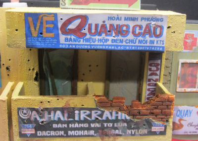The signs were downloaded from the net, then stressed and weather before attaching. Note the battle damage and bullet holes which covered every building that I saw even a year later.Note the rust stains on the doors and windows. The broken glass was made from clear plastic containers cut to size.