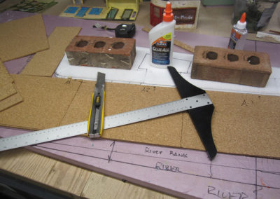 The base was made from pink foam insulation, while the stree is made from cork, and the sidewalk from Depron foam board