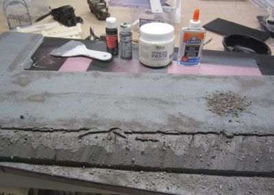 The road was made of cork covered and textured with acrylic  modelling paste and then painted in various shades of black and grey