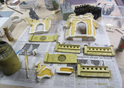 Construction of the temple. I cast the walls in plaster after making initial clay and wood samples. The gates were from an old Verlinden kit that I converted using 2 part putty. The inserts were from chinese charms found on line.