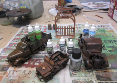 Weathering and painting battle damaged vehicles and metal accessories done with acrylic paints. Hair spray after a base coat of rust colors can then be scraped off with water and a toothpick to show realistic damaged effects