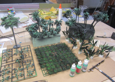 Various plants and trees bought on ebay are then painted using an airbrush in various shades of green after a first coat of black primer