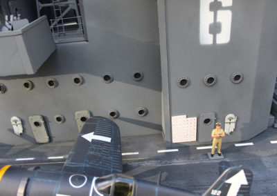 Nautical details like port holes, hatches and fire hoses added realistic detail. The large white board with small Japanese flags shows the number of enemy planes shot down by the Bunker Hills pilots.
