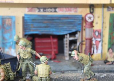 Hidden enemy machine guns raked the street from all sides