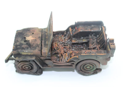 Burned out jeep-took a commercial jeep and using wire and metal shavings and mixtures of paint colors turned it into a casualty of war.