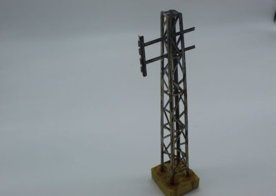Communications pole found throughout SE Asia constructed from plastic and detailed with rust colored paints