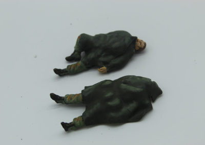 Dead Marines wrapped in their ponchos sculpted out of 2 part putty. I made my own as there are no commercial figures to depict this part of the battle.