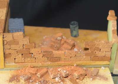 Bricks cut from cork used to show partial construction of roof