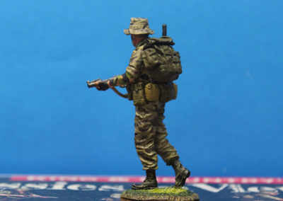 I sculpted the rucksack and other pieces of equipment out or 2 part epoxy putty. He is dressed in Tiger stripe fatigues, which many SF  troops from various units and countries prefered. I used a No 0  brush to paint black and brown stripes over a khaki base,