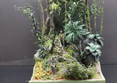 The jungle was thick, wet, oppressive and difficult to move through when on patrol, especially since you wanted to stay off trails, with lots of things that can bite or hurt you, which I tried to convey in this diorama.