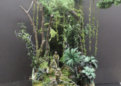 "The diorama is 8"" square and 20"" high. Note the hanging vines made from string dipped in white glue and then covered in hobby store grated green foam."