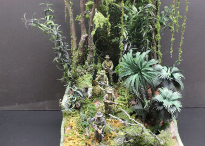 A US Special Forces recon patrol emerges from the jungle in Cambodia. The diorama was built on 4 levels to show off the unique uniforms that each man often wore on patrol