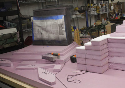 Pink foam board is my go to material for bases and large buildings like the temples. After I score in the rock or brickwork, I spray everything with black auto primer, being careful not to damage the foam by using multiple light coats