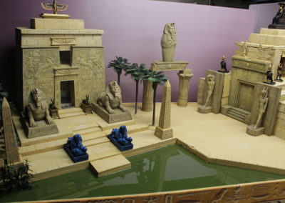 The water feature, made with Magic Water 2 part epoxy. The hieroglyphic facade is textured wall paper I found in China and attached to Depron foam strips. that face the entire diorama