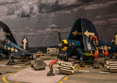 The aft deck flight operations crew prepare the corsairs for launch and combat. The JJ planes are full of detail as are the crew members, all of whom make the scene pop with their colorful duty uniforms