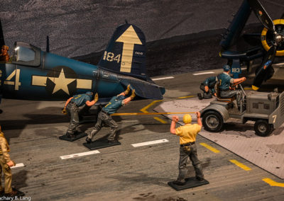 Moving planes on a crowded flight deck requires multiple hands
